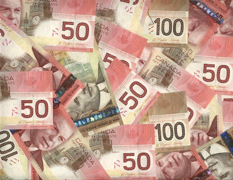 background of canadian fifty and hundred dollar bills 2910964 Large - زوج دولار/دولار كندي USD/CAD يرتفع إلى مقاومة 1.3075-80 وسط ضعف أسعار النفط